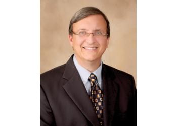 Orlando pain management doctor Eugene A. Melvin Jr, MD