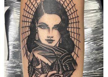 Pomona tattoo shop Flying Daggers Tattoo Parlor