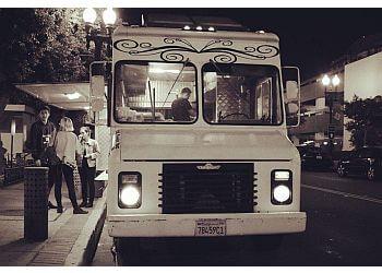 Orange food truck Frida Food Truck