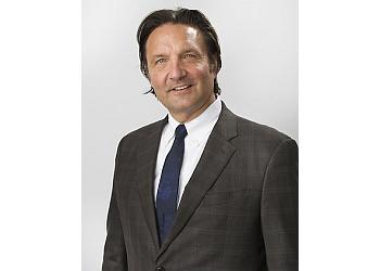 Detroit patent attorney  George Schooff