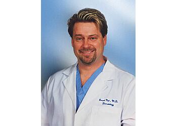 Downey dermatologist Gerard Nat, MD