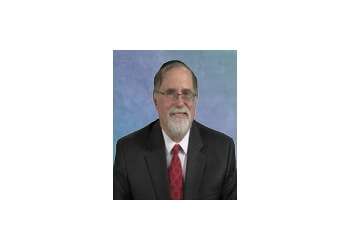 Cleveland patent attorney Howard M. Cohn