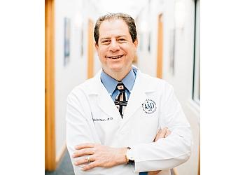 Omaha dermatologist Joel Schlessinger, MD - SKIN SPECIALISTS P.C.