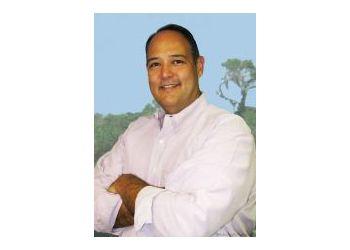 Tampa physical therapist JOHN A. HISAMOTO, PT