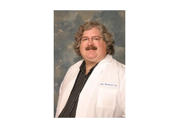 Palmdale primary care physician John A. Woodcock, DO