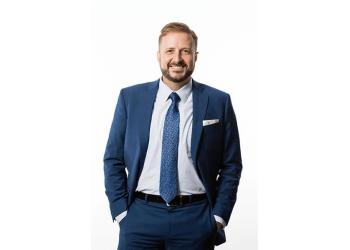El Paso immigration lawyer John Benjamin Moore - VILLALOBOS & MOORE