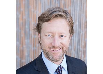 San Diego patent attorney John K. Buche