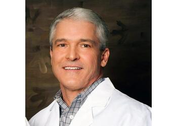 Huntsville dermatologist John K. Sowell, MD