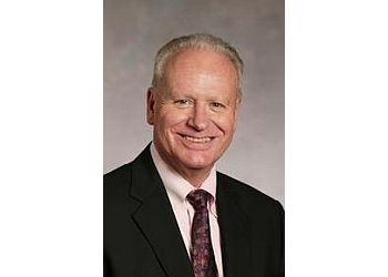 Tacoma neurologist John R. Huddlestone, MD