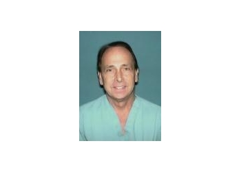 Tulsa gynecologist John R. Thompson, MD