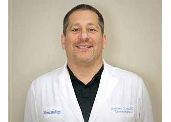 Wilmington dermatologist  Jonathan Crane, DO, FAAD, FAOCD