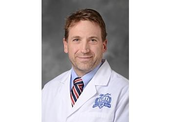 Detroit plastic surgeon Kenneth J Moquin, MD