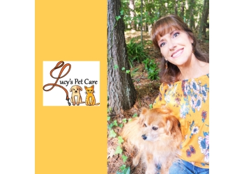 Durham dog walker Lucy's Pet Care LLC.