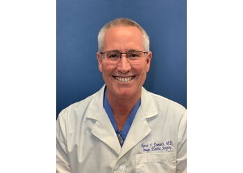 Long Beach plastic surgeon MARCEL F. DANIELS, MD, FACS, FICS
