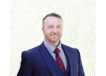 Phoenix immigration lawyer MATTHEW C. THOMAS