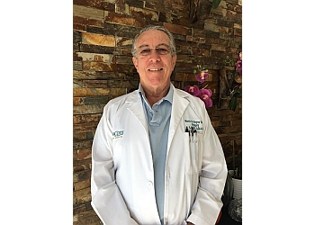 Hialeah plastic surgeon Mario E. Reyes Serrano, MD