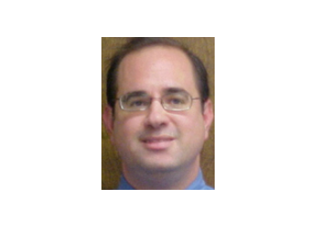 Denver neurologist Mik K. Stambuk, MA, MD