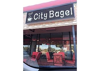 Orange bagel shop Our City Bagelry