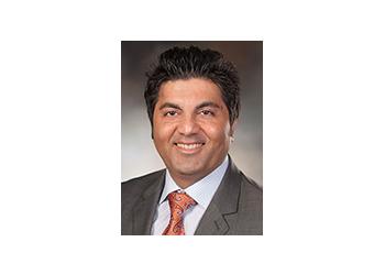 San Antonio neurologist Reza Behrouz, DO