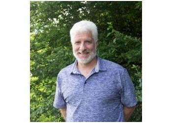 Lansing physical therapist Scott Benjamin, PT, DScPT, COMT