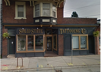 3 best tattoo shops in milwaukee wi threebestrated for Solid state tattoo