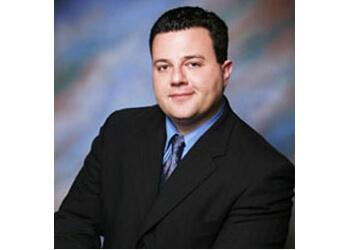 Tampa business lawyer Spiro T Komninos - Komninos Law Firm PA