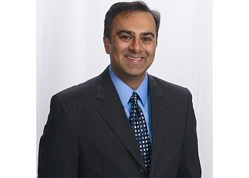 Riverside plastic surgeon Subhas Gupta, MD, CM, PHD, FRCSC, FACS