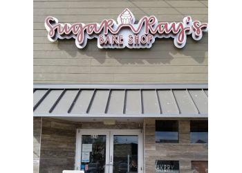 Plano cake Sugar Ray's Bake Shop