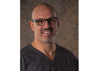 Henderson plastic surgeon TRACY W. HANKINS, MD