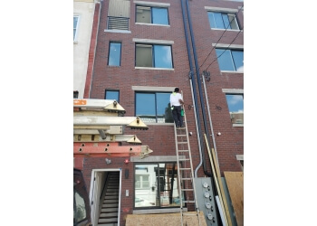 Philadelphia window cleaner Touch Window Cleaning