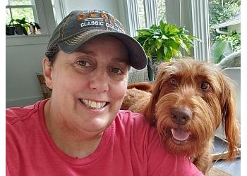 New Orleans dog walker Uptown Girls Pet Services, LLC