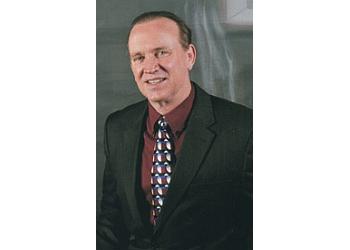 Peoria dermatologist Vernon T. Mackey, DO
