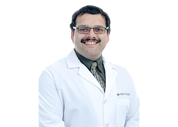 Grand Rapids cardiologist Vinayak Manohar, MD