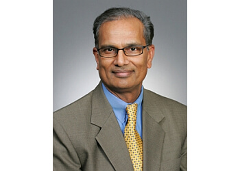 Kansas City plastic surgeon Virender K. Singhal, MD, DA, LRCP, MRCS, FRCS, FACS, FAAP, MBA