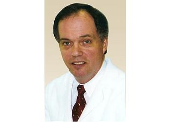 Columbus dermatologist WILLIAM H. PAULL, MD